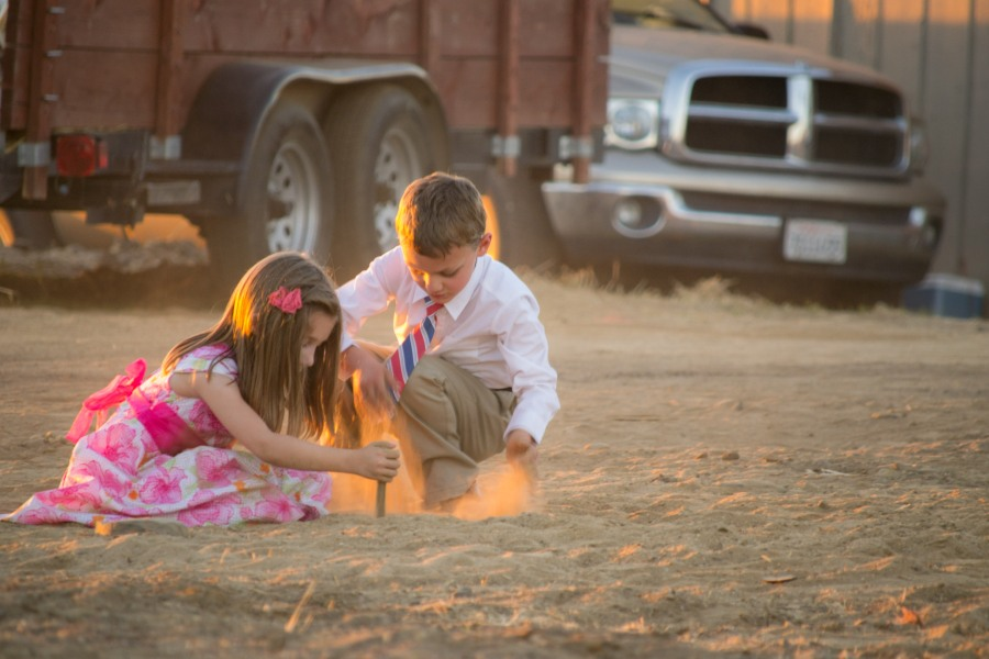 Family photography siblings dirt sunset