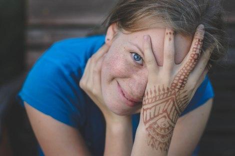Portrait photography blue eye henna hand