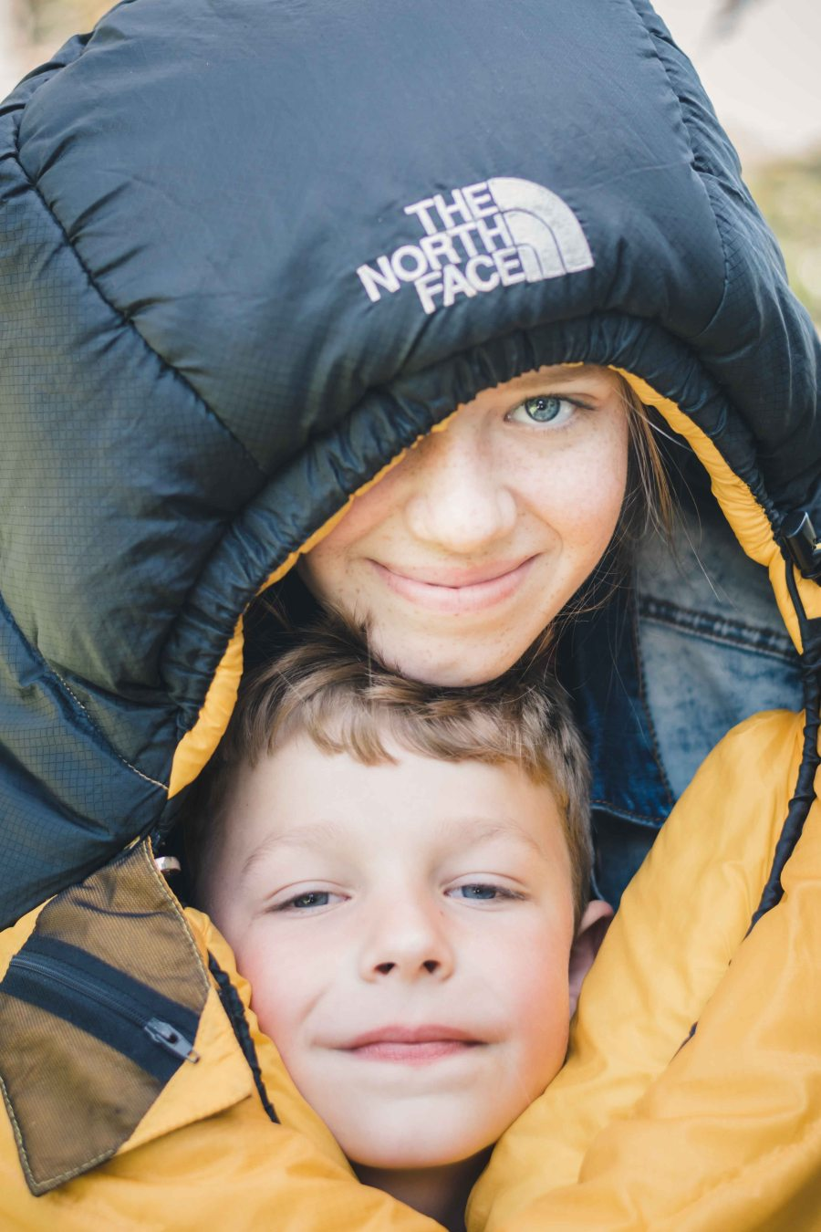 Family photography sister brother sleeping bag