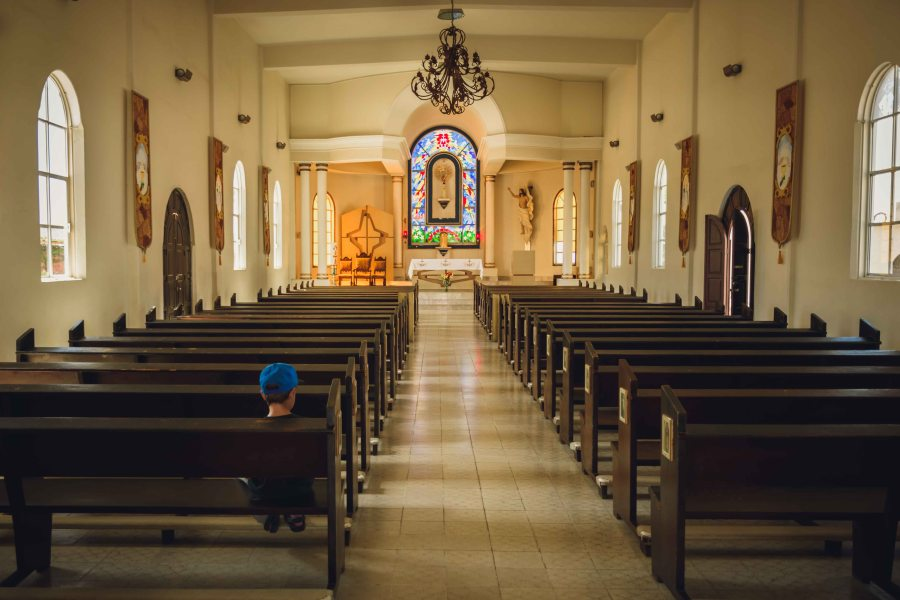 family photography solitary boy at church