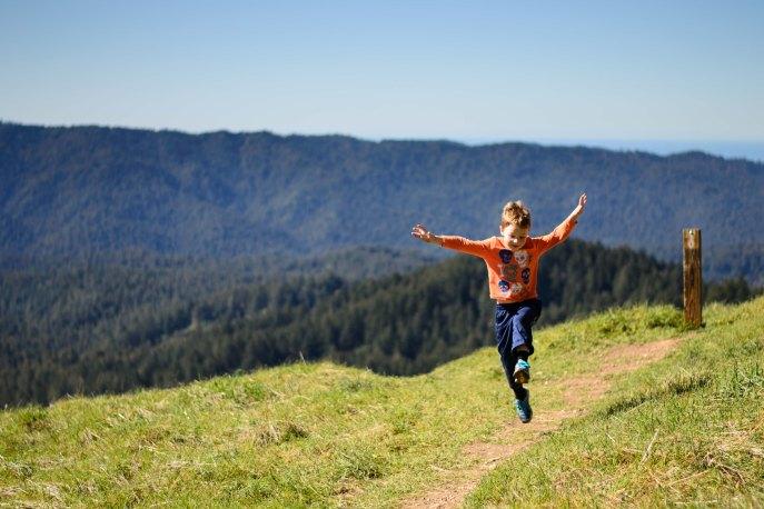 environmental portrait outdoor wilderness photography boy skipping trail longridge open space preserve