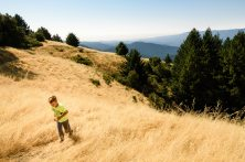 environmental portrait outdoor nature wilderness photography boy exploring golden hillside