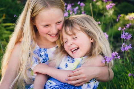 Portrait of sisters photographed on the lawn during a family photography session in the Bay Area