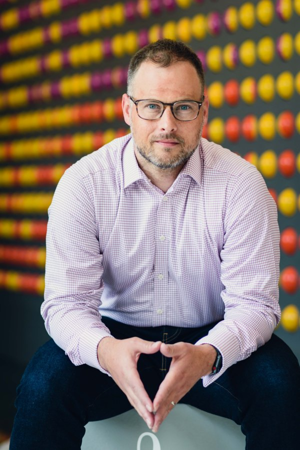 Portrait photography executive business headshot man glasses indoors at Adobe