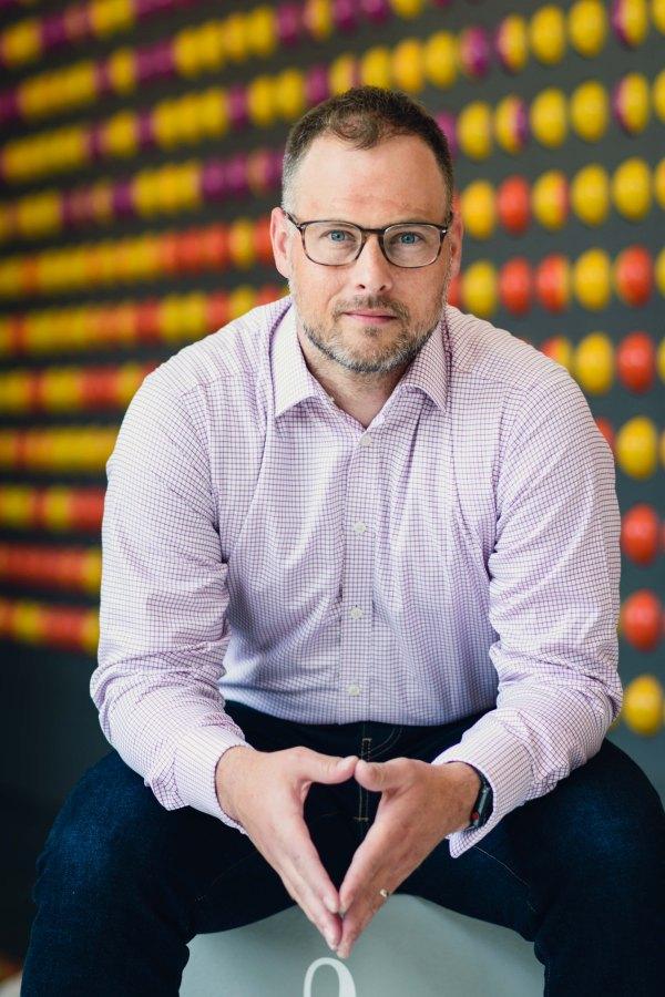 Portrait photography executive business headshot man glasses indoors at Adobe