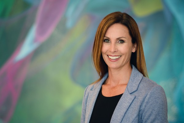 Portrait photography executive business woman headshot indoors at Adobe