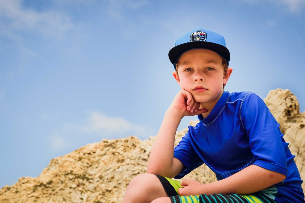outdoor portrait boy blue sky