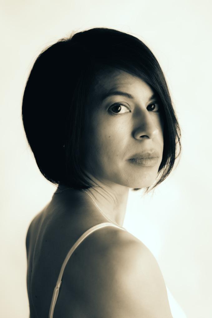 black and white portrait woman eyes shoulders hair
