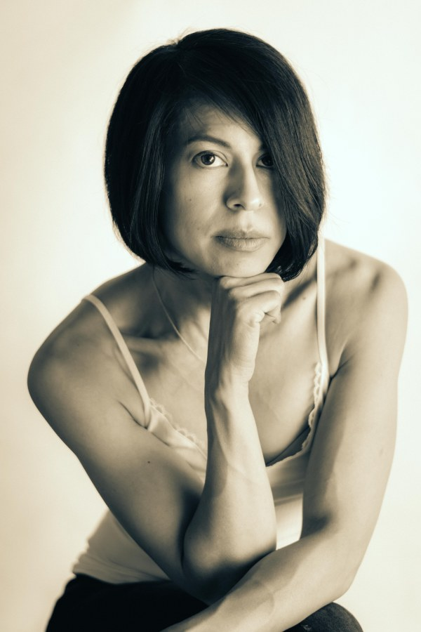 Portrait photography black and white woman eyes shoulders hair arms intensity