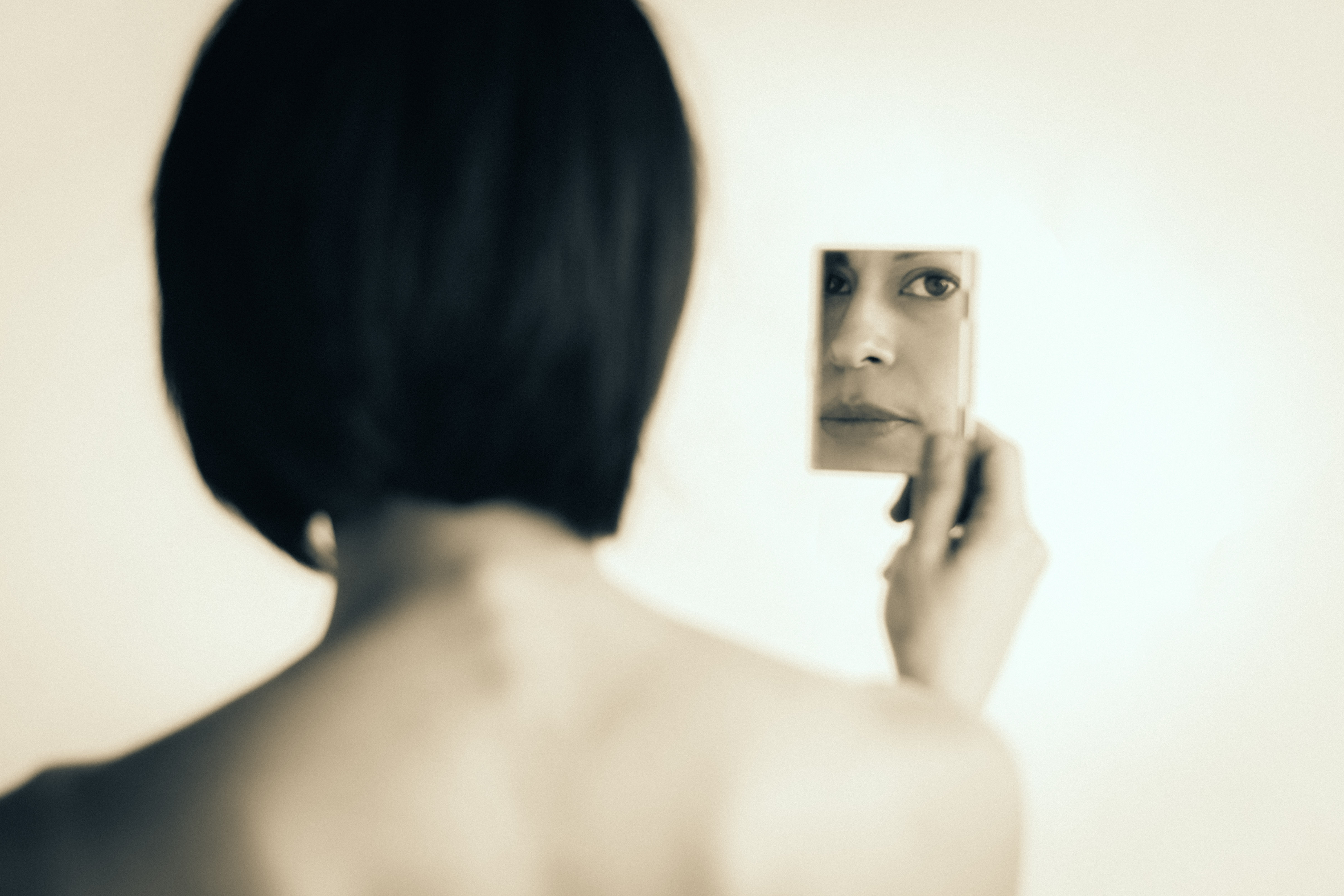 Portrait photography woman holding a mirror fine art monochrome