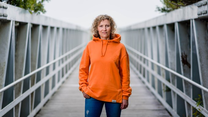 corporate portrait photography bay area half moon bay santa cruz healo ceo headshot orange sweatshirt bridge