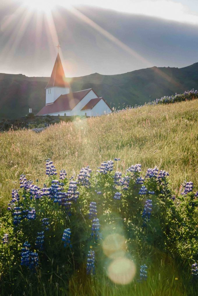 neilson bay area travel photography iceland church sun flare