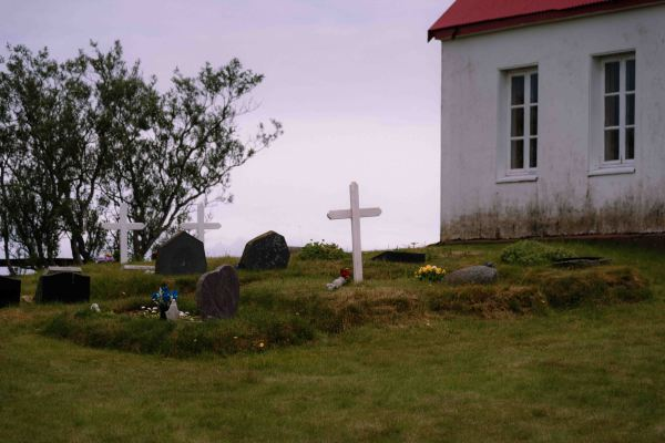 neilson bay area travel photography iceland church cross cemetery