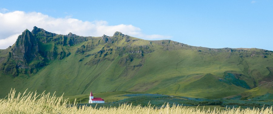 neilson bay area travel photography iceland church grass mountains