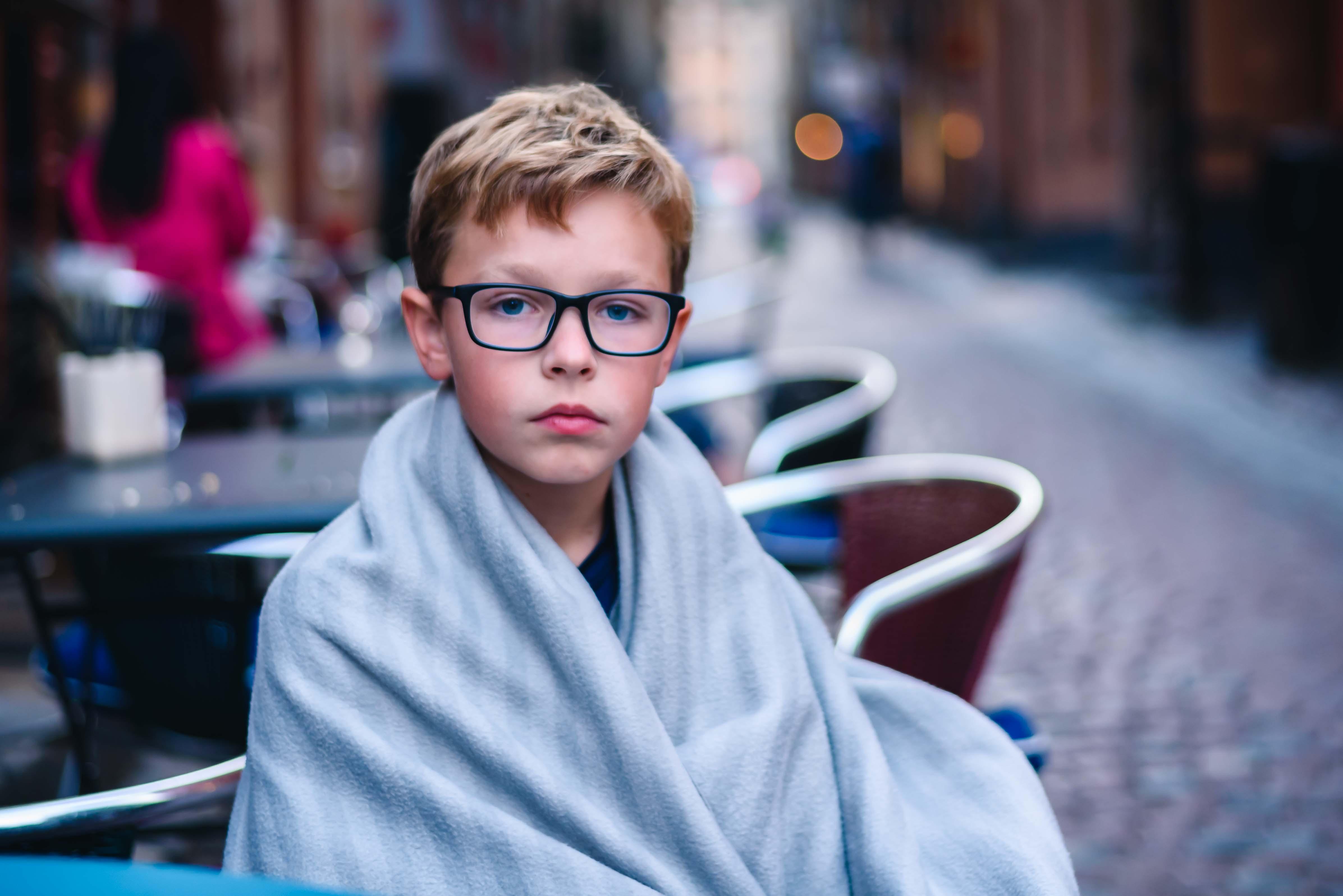 neilson family portrait travel photography boy glasses blanket sweden stockholm gamla stan