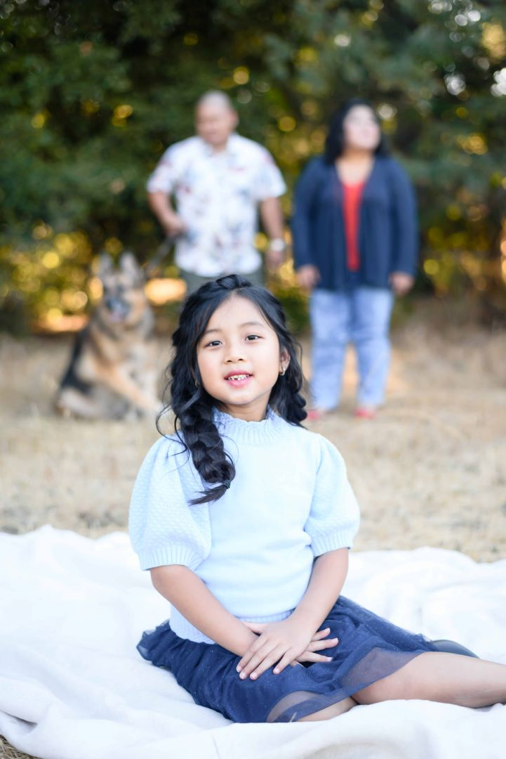 neilson outdoor family photography mcclellan ranch cupertino bay area daughter family in back