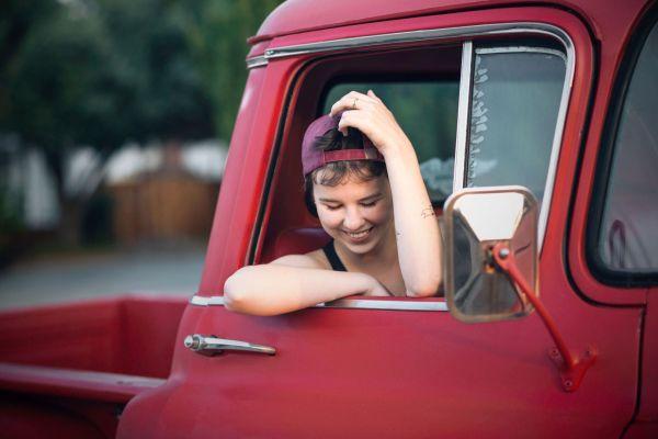 grace grit photo essay bay area photographer san jose red truck tattoos short hair passenger seat baseball hat shy